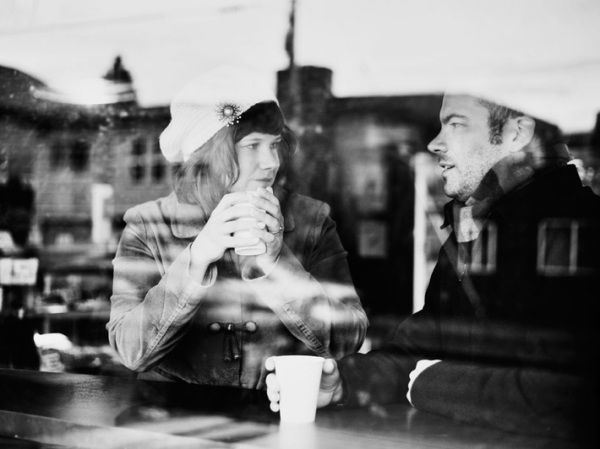 engagement-couple-talking-coffee-shop-92564